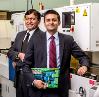 Charlotte-based American Circuits founder Vic Gondha (left) and his son Ket; Business Portraits